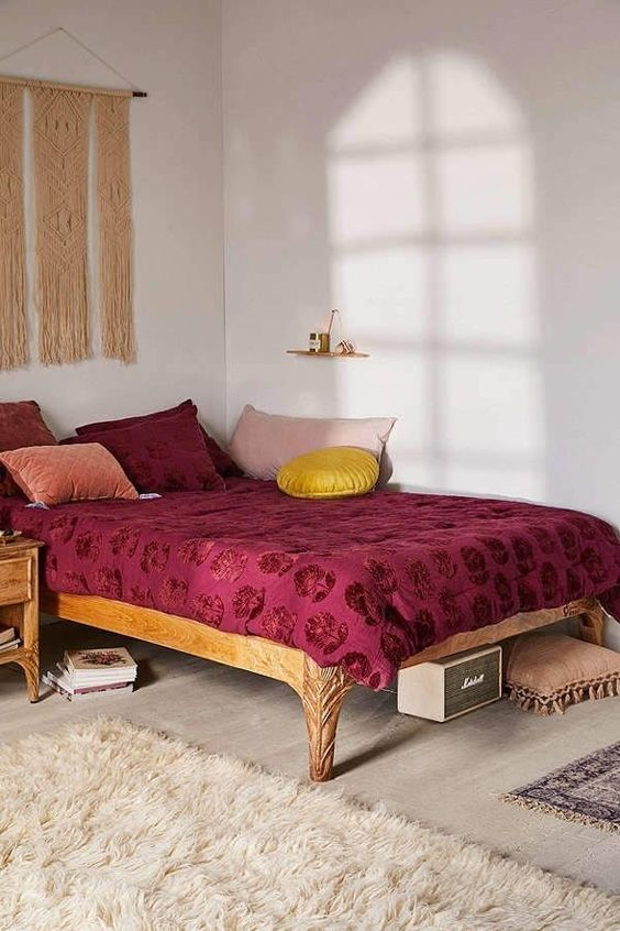 a printed burgundy blanket and pillows are right what you need for a fall bedroom