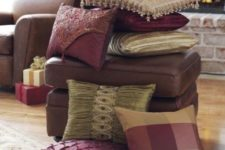 a stack of refined fall colored pillows – neutral, burgundy and plaid and embellished for the fall