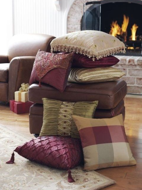 a stack of refined fall colored pillows   neutral, burgundy and plaid and embellished for the fall
