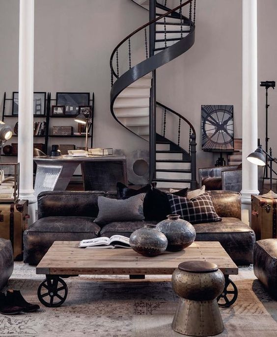 an industrial living space with metal furniture and accessories, leather furniture, a table on wheels
