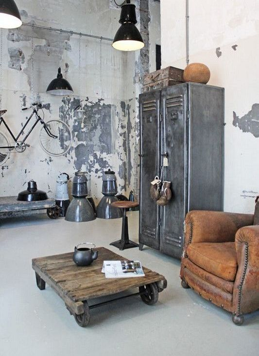 shabby chic walls, a vintage metal storage unit, leather furniture, retro metal lamps and a table on casters