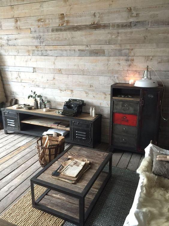 weathered wood floor and walls, an industrial wood and metal coffee table, vintage metal furniture