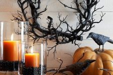 a black branch wreath is a gorgeous idea for Halloween, it's easy to DIY and it looks scary enough to use it