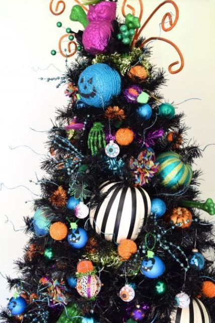 a bold Halloween tree in black, with colorful ornaments, skeleton hands, eyeballs and beads is fun