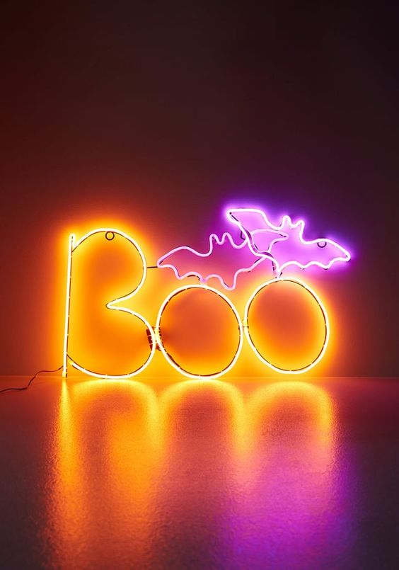 a bold neon pink and yellow sign for Halloween decor is an amazing and very fresh idea to rock