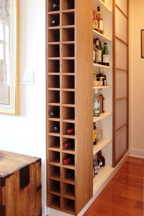 a built-in minimalist plywood shelf somewhere on the corner is a smart idea for storing your wine bottles