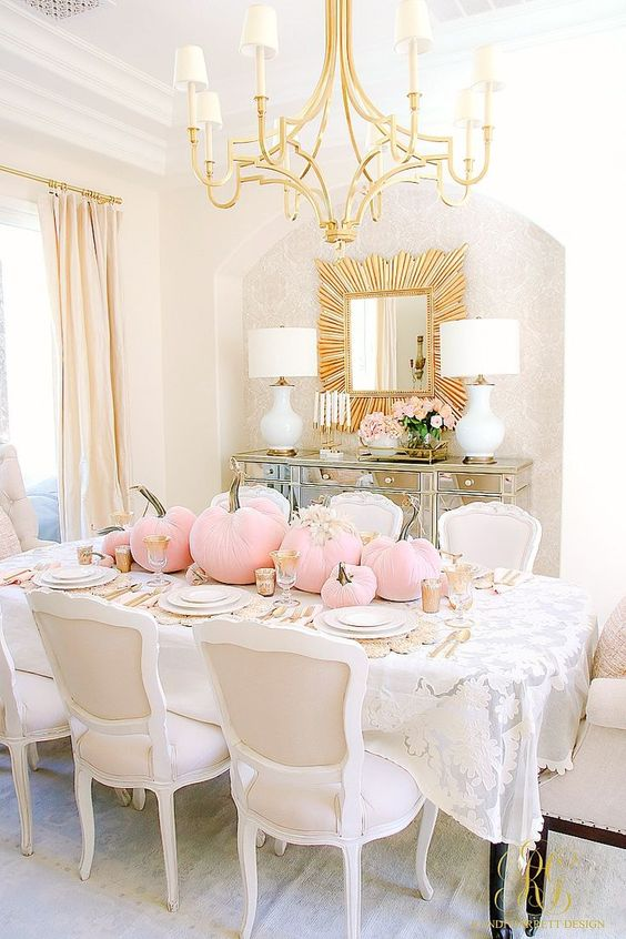a chic glam Halloween table setting with pink velvet pumpkins, gold touches and white plates