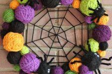 a vibrant halloween wreath with yarn balls