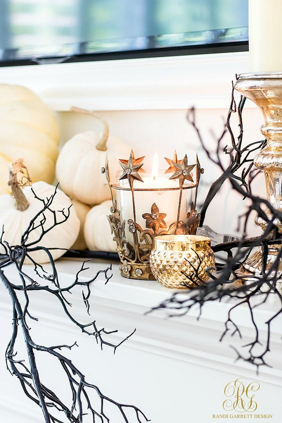 a glam celestial candleholder, a gold one, spooky branches and white pumpkins for chic Halloween decor