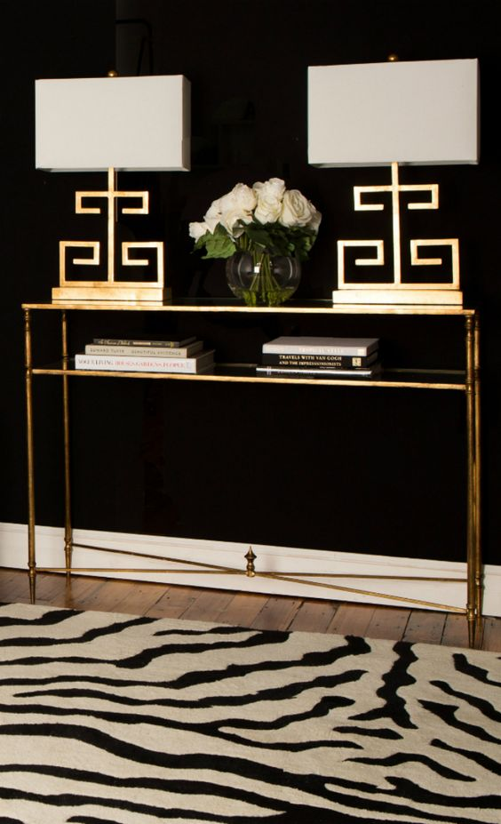 a gold console table with a shelf, matching gold table lamps will give a strong glam feel to the room
