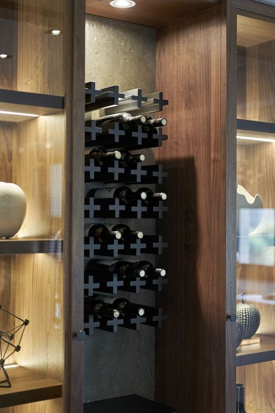 a quirky X shelf built into a cabinet for wine storage is a stylish and lighweight idea
