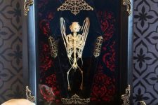 a refined Halloween art piece – a bat skeleton in a coffin and in a refined frame is great for Halloween decor