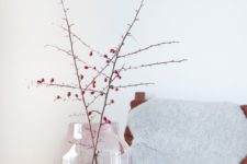 a stylish pink and copper vase with branches with berries is a cool fall Nordic decoration