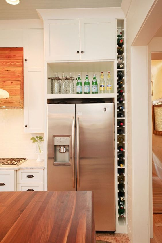 a vertical wine shelf built in between the wall and the fridge will save your space