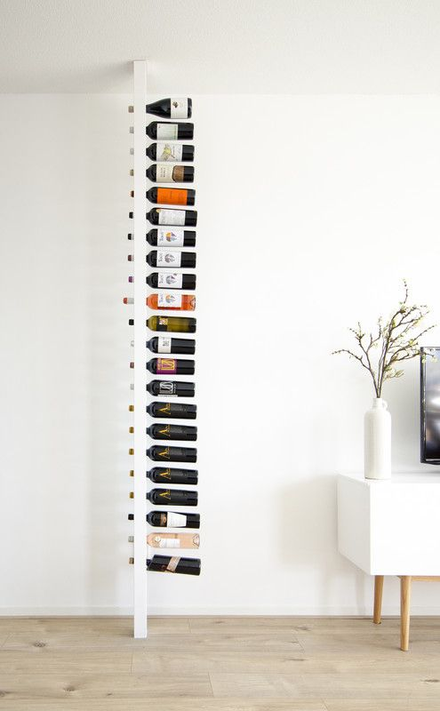 a white vertical rack for wine bottles is very cool and won't take much space in your dwelling