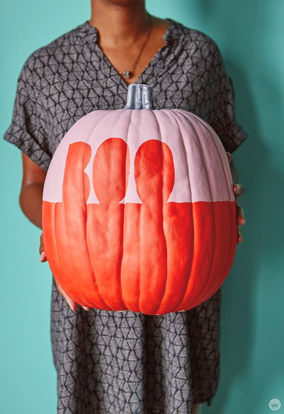 an oversized color block red and pink pumpkin with BOO letters is amazing for Halloween