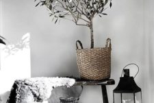 baskets, candles, a faux fur piece add a natural feel to the Nordic space and keep the monochromy up