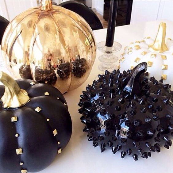 black and copper pumpkins decorated with spikes, studs and beads look very bold and cool