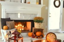 bright fall leaf arrangements, orange pumpkins and fall blooms bring a strong fall feel to the space
