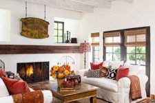 fall-colored textiles and a bright fall bloom arrangement in a basket make this lviign room more fall-like