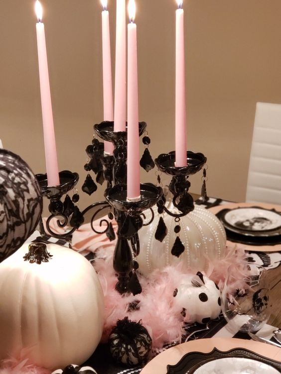 glam Halloween styling with white pumpkins, a black candelabra with pink candles and lace