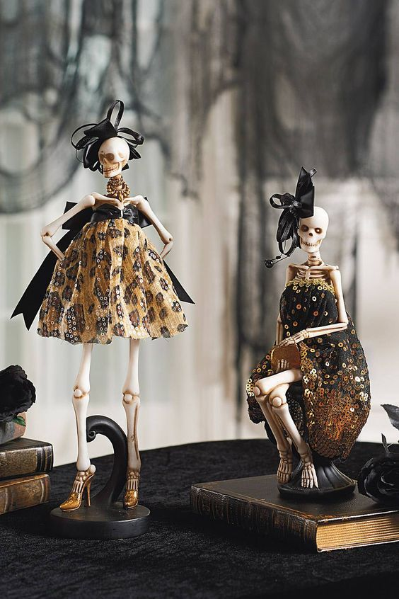 glam ghoulish decor - skeleton in designer dresses and with large bows - is great for Halloween