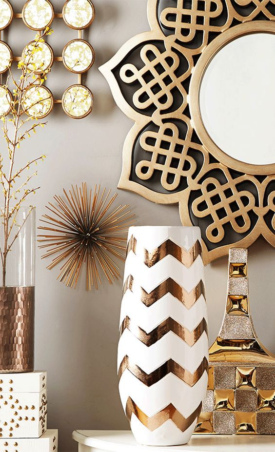 glam gold and brass decor - vases, a mirror in an ornated frame, a sign and others will be amazing for styling your space