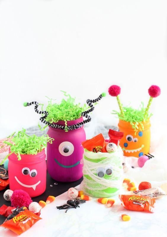 neon monster jars with googly eyes are amazing for kids' Halloween parties and you can DIY them