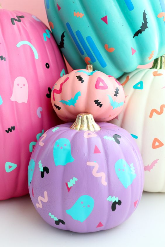 neon pink, purple, turquoise pumokins decorated with bold sharpies are a fun and cool idea for Halloween