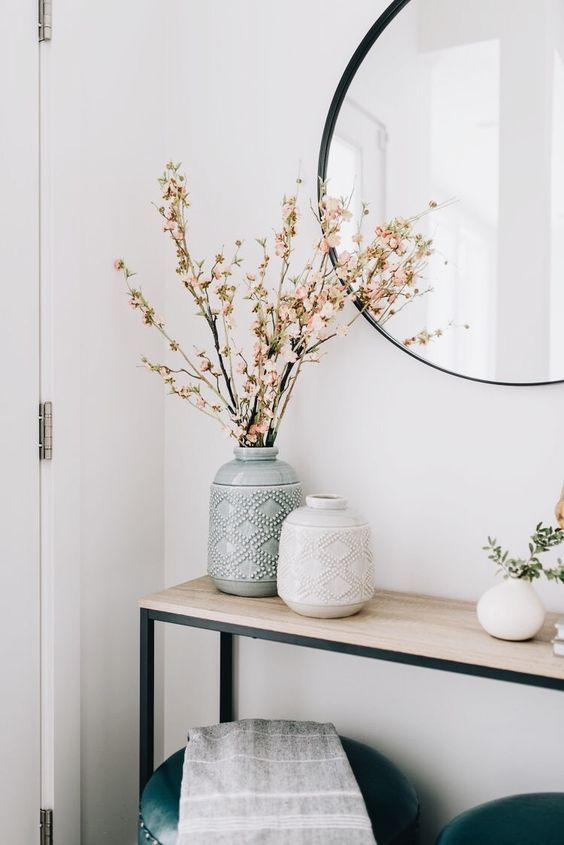 patterned neutral vases with branches and blooms for simple Nordic decor