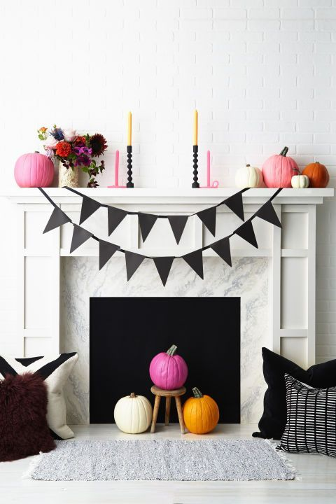 pink, orange and white pumpkins, pink and mustard candles, bright floral arrangements for Halloween