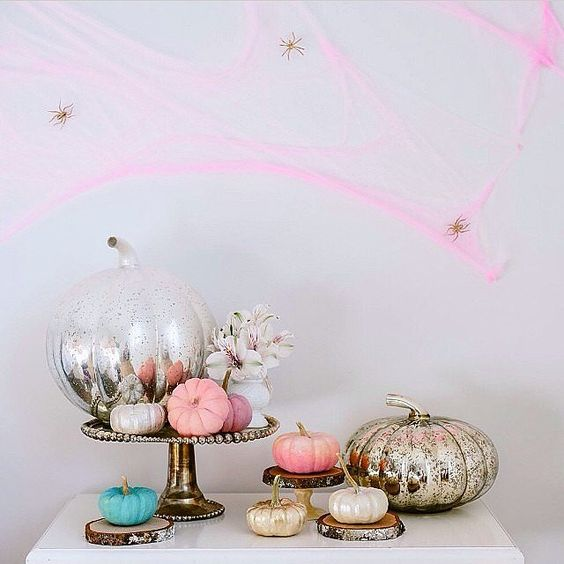 pink spiderweb with gold spiders, mercury glass and pink pumpkins for non-traditional Halloween decor