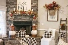 plaid textiles, pumpkin stacks, fake leaf garlands and arrangements and a statement sign