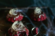 red velvet molten lava cakes with chocolate ganache and spun sugar on top for a Halloween party