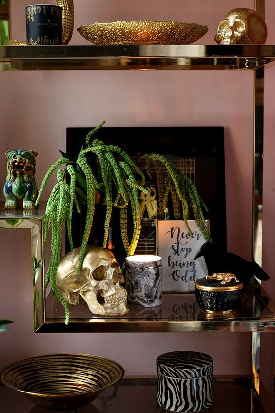 refined and glam Halloween styling with an artwork, a crow, black skulls and some candles