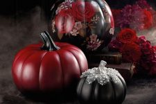 refined red and black Halloween pumpkins with floral painting and sequins and embellishments