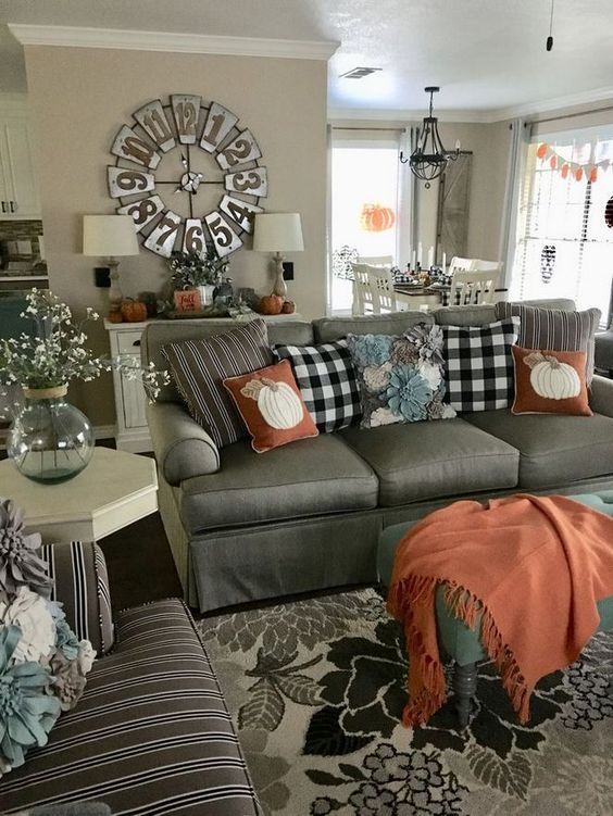 rust-colored textiles and plaid pillows make this farmhouse living room very fall-like