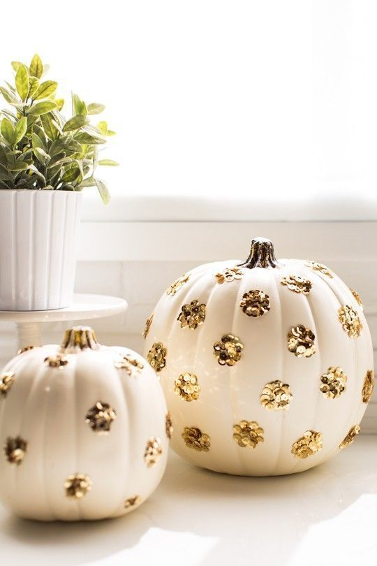 white pumpkins decorated with gold sequin polka dots are perfect for both fall and Halloween decor