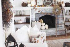 white pumpkins, fall leaf garlands, a grass wreath, fall leaf arrangements and a cool fall leaf pillow