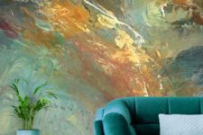 a bold abstract wall mural in greens, blues and bold matches the color scheme of the room and brings a colorful touch