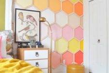 a bright hexagon wall mural brings a lot of color to the bedroom making it cheerful and fun and you can choose items to match it