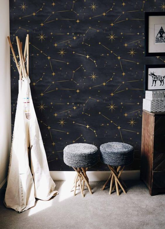 a celestial black and gold wall mural is a fantastic idea to renovate a space, it's trendy and very whimsy