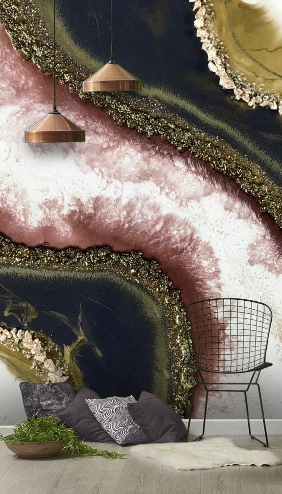 a fantastic bold geode wall mural in dark green, black, gold, pink and white looks very refined