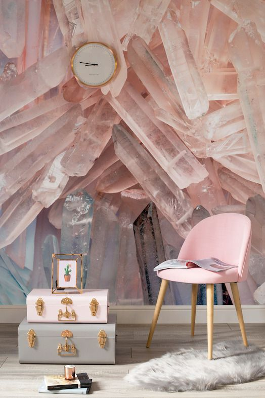 a gorgeous crystal wlal mural in pink matches the pink chair and suitcase and brings an edgy feel to the space