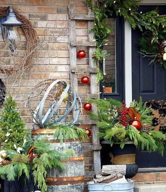 a ladder, a barrel, a galvanized bathtub with firewood, vine wreaths, pinecones and fir branches for cozy rustic decor