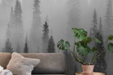 a moody forest wall mural harmonizes the space and makes it more relaxing yet very eye-catching at the same time