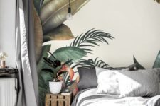 a neutral bedroom is totalyl changed with a bold tropical wall mural that creates a mood in the space