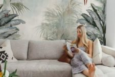 a neutral living room made catchy and bold with a large tropical wall mural that makes the space adventurous