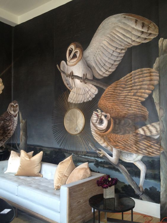 a refined living room with a unique owl wall mural that makes the space feel artsy and very unique