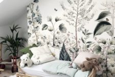 a romantic kid's space with a beautiful botanical wall mural and potted plants that match it